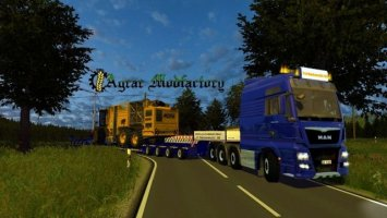 MAN TGX Euro6 with low loader